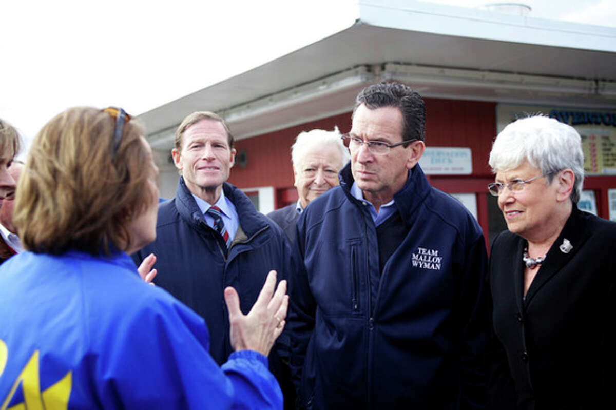 Hour photo / Danielle Robinson U.S. Sen. Richard Blumenthal, Gov. Dannel Malloy and Lt. Gov. Nancy Wyman speak to Karen Mills from the Small Business Administration's Disaster Relief about small businesses damaged by Hurricane Sandy during a meeting at Overton's in Norwalk Saturday afternoon.