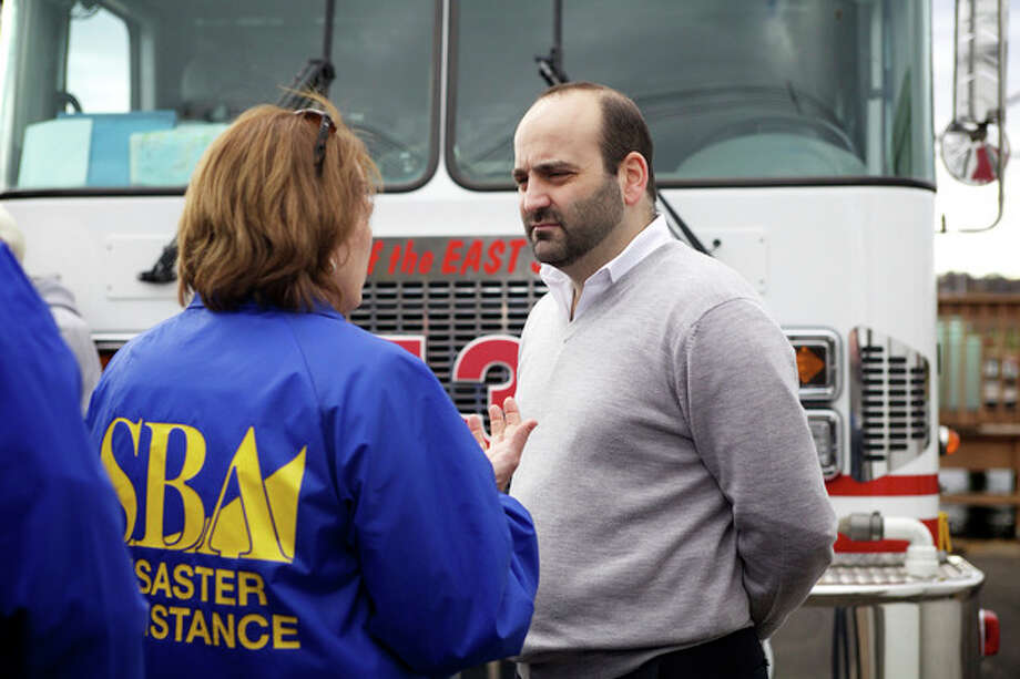 Overton's co-owner Chris Gavrielidiss speaks to Karen Mills from SBA Disaster Relief during a meeting about small businesses that were damaged during Sandy in Norwalk Saturday afternoon.Hour Photo / Danielle Robinson
