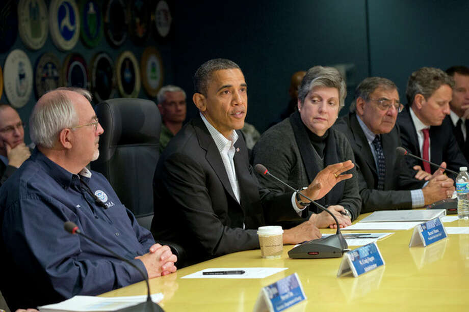 President Barack Obama visits the Federal Emergency Management Agency (FEMA) for an update on the recovery from Hurricane Sandy that hit New York and New Jersey especially hard earlier this week, Saturday morning, Nov. 3, 2012, in Washington. He is flanked by FEMA chief Craig Fugate, left, and Homeland Security Secretary Janet Napolitano, right. Next to Napolitano is Defense Secretary Leon Panetta and Treasury Secretary Timothy Geithner, far right. (AP Photo/J. Scott Applewhite) / AP