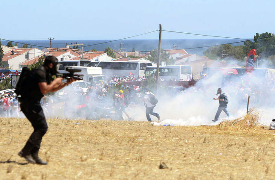 Riot and paramilitary police officers fire tear gas and use water cannons to disperse protesters outside the Silivri jail complex in Silivri, Turkey, Monday, Aug. 5, 2013. Some 275 people - including military officers, politicians and journalists - are facing verdicts in a landmark and divisive trial in Turkey over an alleged conspiracy to overthrow the government. (AP Photo) / AP