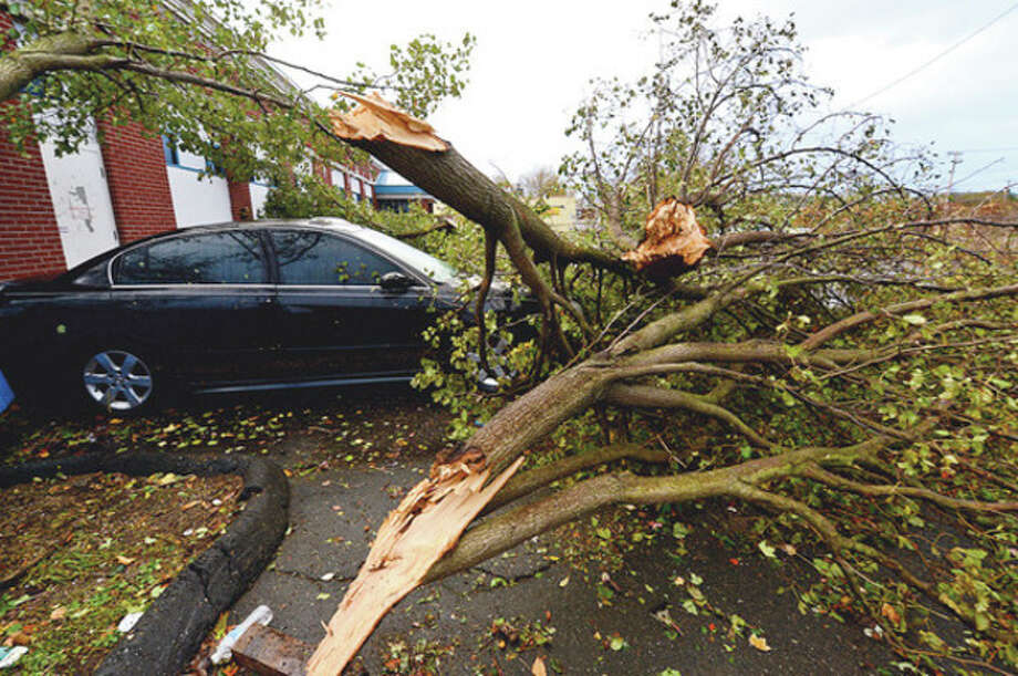 Neighborhoods near the waterfront in Norwalk were inundated with storm surge and high winds bringing down trees, blocking streets and damaging vehicles.Hour photo / Erik Trautmann / (C)2012, The Hour Newspapers, all rights reserved