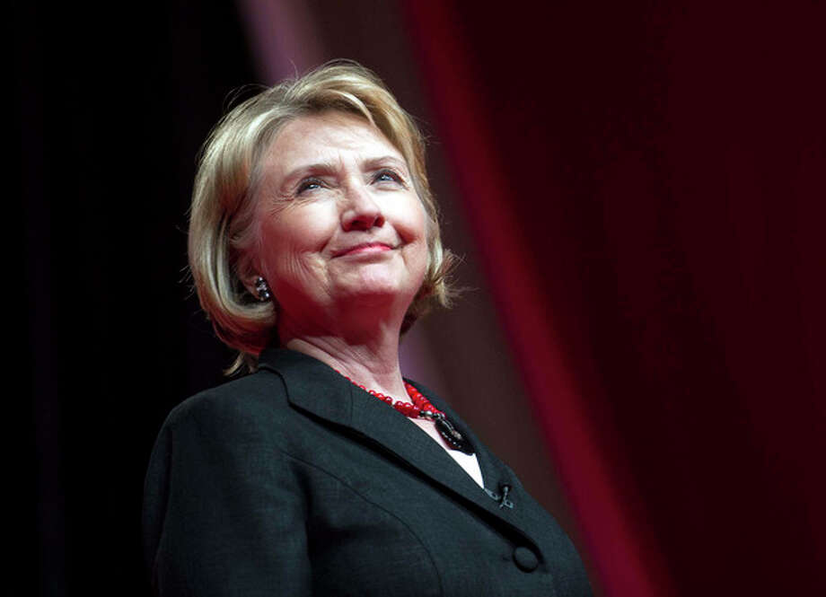 "FILE - This July 16, 2013 file photo shows former Secretary of State Hillary Rodham Clinton during the 51st Delta Sigma Theta National Convention in Washington. The Republican National Committee wants NBC and CNN to cancel upcoming programs on Hillary Rodham Clinton and is threatening to blackball the television networks from future Republican presidential debates if they fail to comply. NBC has announced a miniseries ""Hillary"" starring Diane Lane. It's expected to be released before the 2016 presidential election. (AP Photo/Cliff Owen, File) / FR170079 AP"