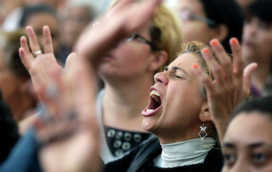 A woman sings during a Mass led by Catholic priest Marcelo Rossi at the Mother of God sanctuary in Sao Paulo, Brazil, Saturday, Nov. 3, 2012. Rossi, a Latin Grammy-nominated Christian music singer and author of best-selling books in Brazil, inaugurated on Friday the massive new Roman Catholic church that will hold about 20,000 worshippers when complete. (AP Photo/Andre Penner) / AP