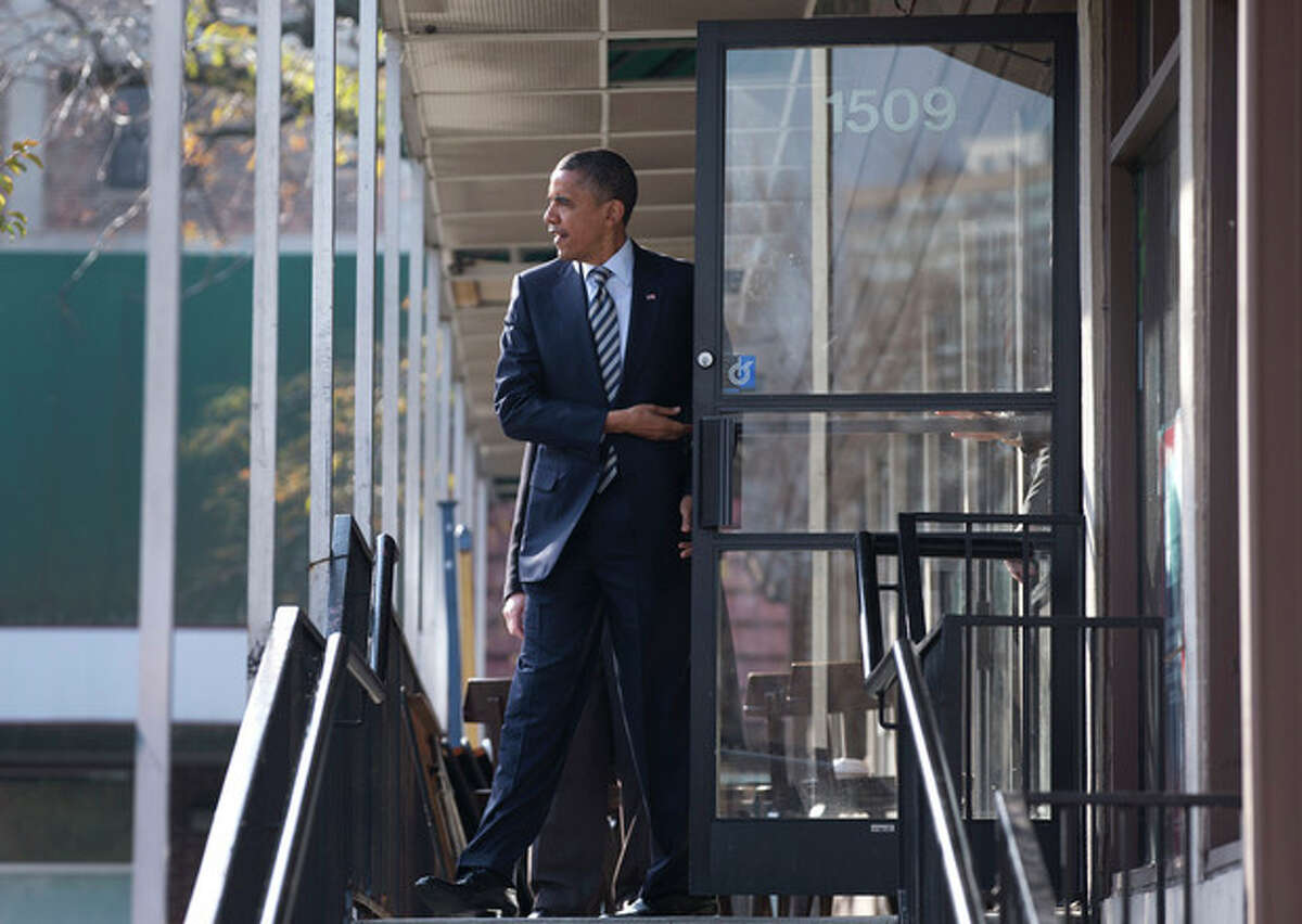 President Barack Obama leaves a campaign office the morning of the 2012 election, Tuesday, Nov. 6, 2012, in Chicago, after visiting with volunteers, making phone calls and speaking to the media. (AP Photo/Carolyn Kaster)
