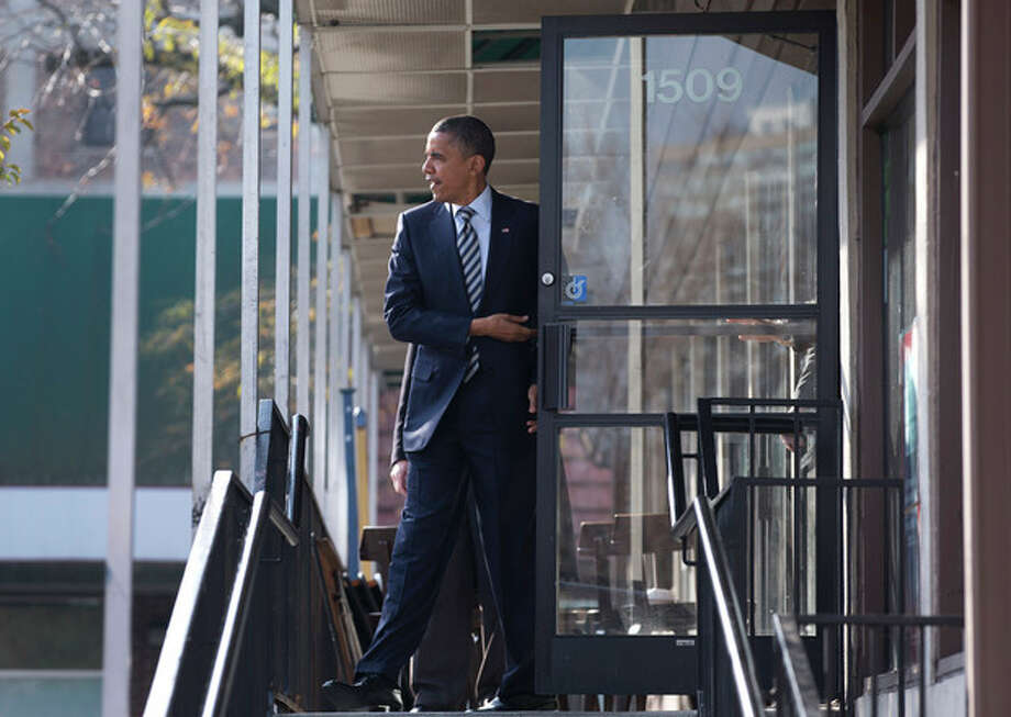 President Barack Obama leaves a campaign office the morning of the 2012 election, Tuesday, Nov. 6, 2012, in Chicago, after visiting with volunteers, making phone calls and speaking to the media. (AP Photo/Carolyn Kaster) / AP