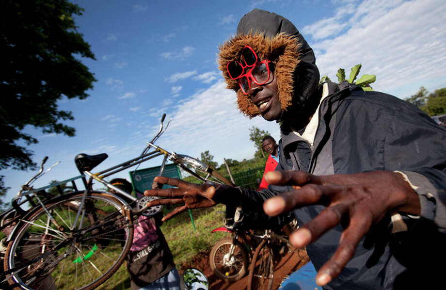 Villagers cheer and raise their bicycles in the air to celebrate Obama's re-election, in the village of Kogelo, home to Sarah Obama the step-grandmother of President Barack Obama, in western Kenya Wednesday, Nov. 7, 2012. (AP Photo/Ben Curtis) / AP