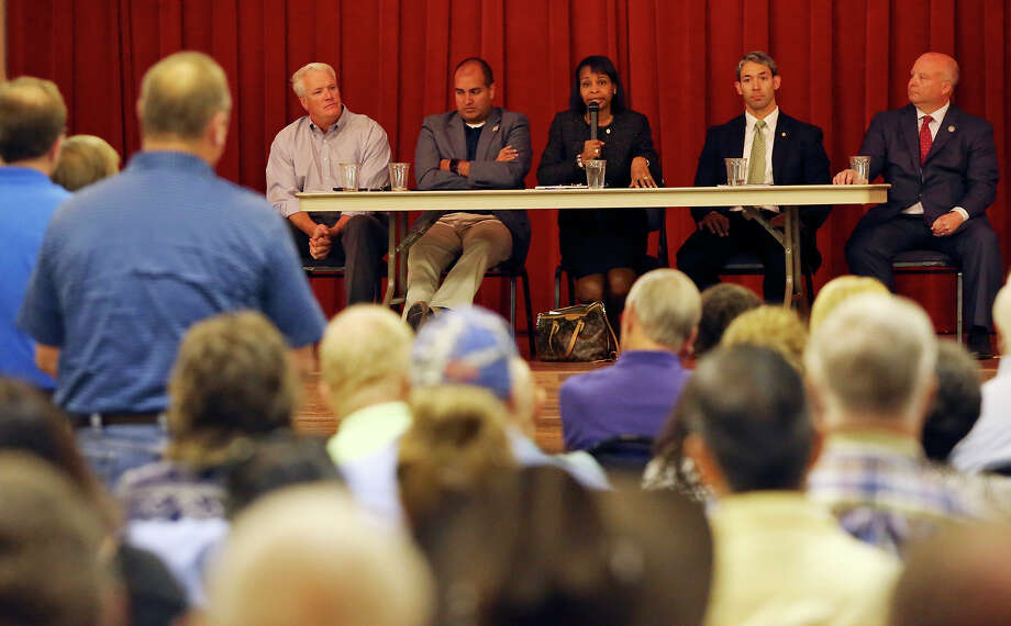 Mayor Ivy Taylor (center) speaks while on stage with state Reps. Lyle Larson (from left), and Rick Galindo, District 8 Councilman Ron Nirenberg, and Bexar County Commissioner Kevin Wolff, during an anti-annexation forum in October 2105 organized by two emergency services districts at the Crown Ridge Banquet Hall. Photo: Edward A. Ornelas /San Antonio Express-News / © 2015 San Antonio Express-News