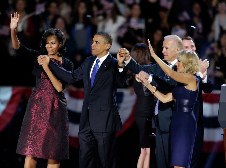 President Barack Obama, first lady Michelle Obama, Vice President Joe Biden and Jill Biden acknowledge the crowd at his election night party Wednesday, Nov. 7, 2012, in Chicago. President Obama defeated Republican challenger former Massachusetts Gov. Mitt Romney. (AP Photo/Chris Carlson) / AP