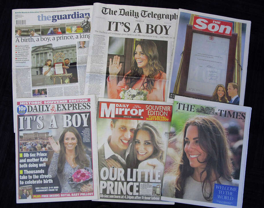 A selection of British daily newspapers on Tuesday July 23, 2013 headlining the news of the birth of a son to Prince William and Kate, the Duke and Duchess of Cambridge. It was announced on Monday that Prince William's wife Kate has given birth to a baby boy. The baby was born at 4:24 p.m. and weighs 8 pounds 6 ounces. The infant will become third in line for the British throne after Prince Charles and William. (AP Photo/Tony Hicks) / AP