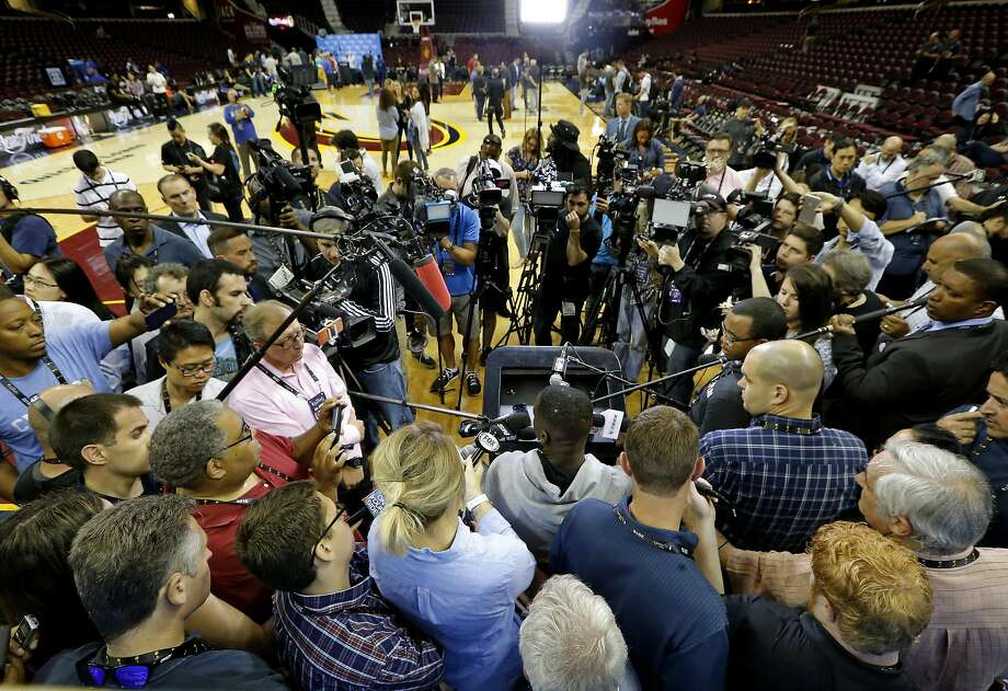 Draymond Green, (bottom center) of the Golden State Warriors during a media availability at Quicken Loans Arena in Cleveland, Ohio on Wednesday. Photo: Michael Macor, The Chronicle