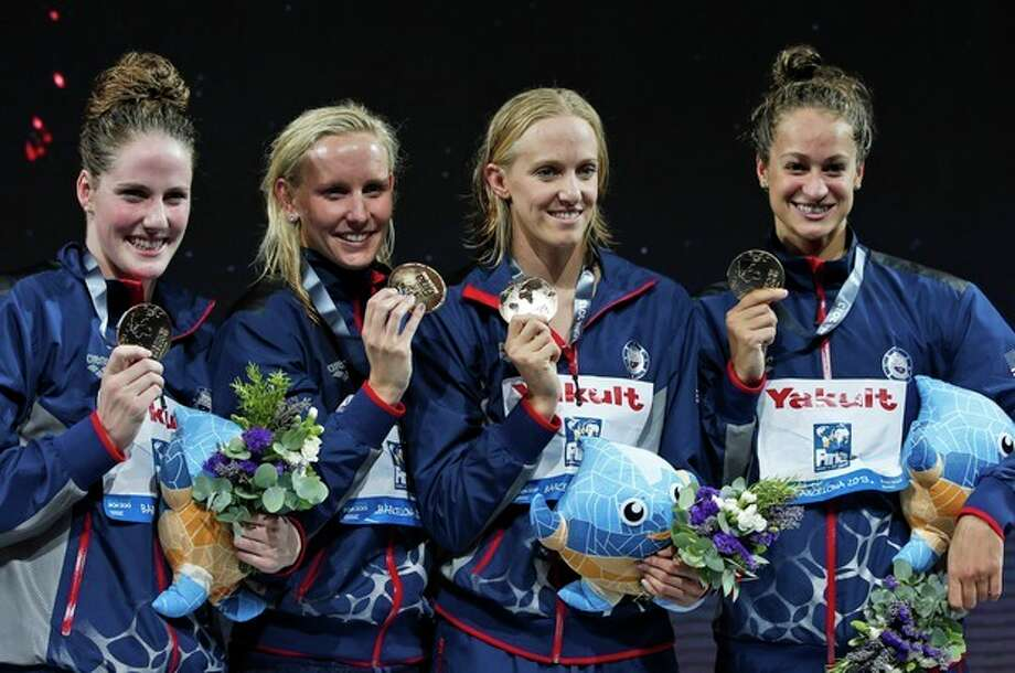 The United States Women's 4x100m medley relay team, from left: Missy Franklin, Jessica Hardy, Dana Vollmer and Megan Romano smile during the presentation ceremony after receiving their gold medals at the FINA Swimming World Championships in Barcelona, Spain, Sunday, Aug. 4, 2013. (AP Photo/Michael Sohn) / AP