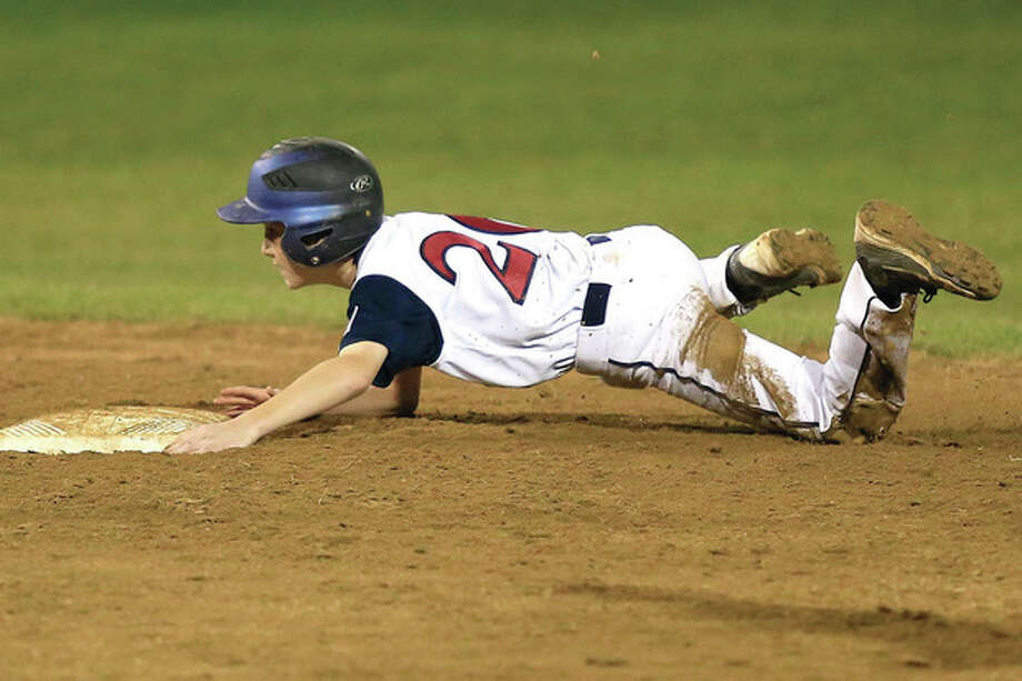 Westport's Drew Roger's slides safely into second during their 12-2 victory over Rye N.H. in the Little League Baseball Eastern Reigional Tournament on Monday night at the Giamatti Little League Center in Bristol, CT. (Hour Photo / Chris Palermo) / © 2013 Hour Newspapers All Rights Reserved