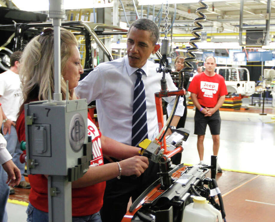 FILE - In this Friday, June 3, 2011 file photo, President Barack Obama tours Chrysler Group's Toledo Supplier Park in Toledo, Ohio. The economy President Obama will face over the next four years remains slow and at risk, but signs suggest that the next four years will coincide with a vastly healthier economy than the previous four, which overlapped the Great Recession. (AP Photo/Charles Dharapak, File) / AP