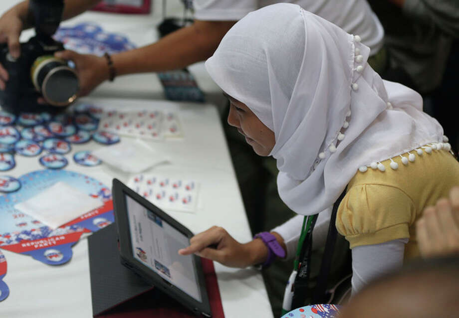 A Muslim student votes in the mock U.S. election at a shopping mall at suburban Quezon city, northeast of Manila, Philippines Wednesday, Nov. 7, 2012. Filipinos participated in a mock U.S. election between President Brack Obama and Republican Mitt Romney which was organized by the US Embassy in Manila. (AP Photo/Bullit Marquez) / AP