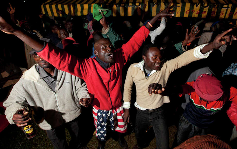 Villagers dance at an all-night party to watch the U.S. presidential election in the village of Kogelo, home to Sarah Obama the step-grandmother of President Barack Obama, in western Kenya Tuesday, Nov. 6, 2012. (AP Photo/Ben Curtis) / AP