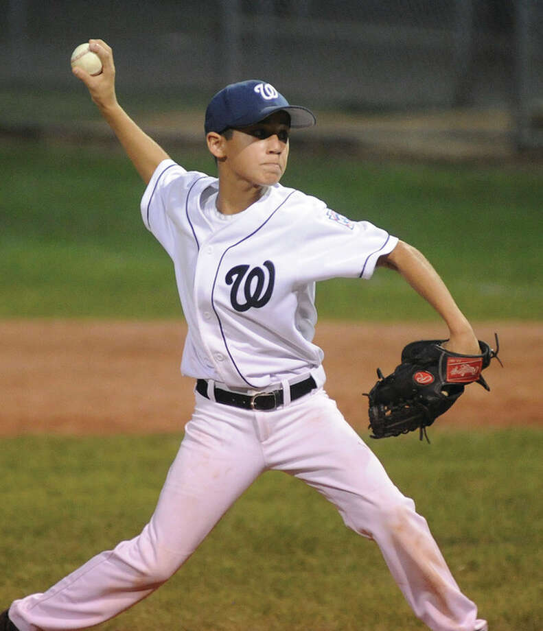 Hour photo/John NashWilton starter Dean DiNanno delivers a pitch during Wednesday's 11-year-old Little League Section 1 tournament game against Orange in Milford. DiNanno and his mates claimed an 8-2 victory.