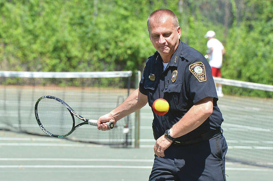 Hour Photo/Alex von Kleydorff . Norwaljk Police Chief Tom Kulhawick returns a volly during Grassroots tennis at Roodner Court
