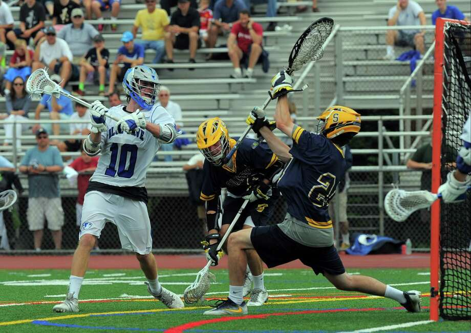 Darien's Riley Stewart prepares to fire a shot past Simsbury goalie Colin Walsh during the CIAC Class L boys lacrosse championship game at Brien McMahon High School in Norwalk on Saturda. Darien won 18-3 to repeat as state champions for the third straight year. Photo: Matthew Brown / Hearst Connecticut Media / Stamford Advocate