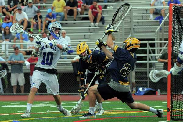 Darien's Riley Stewart prepares to fire a shot past Simsbury goalie Colin Walsh during the CIAC Class L boys lacrosse championship game at Brien McMahon High School in Norwalk on Saturda. Darien won 18-3 to repeat as state champions for the third straight year.
