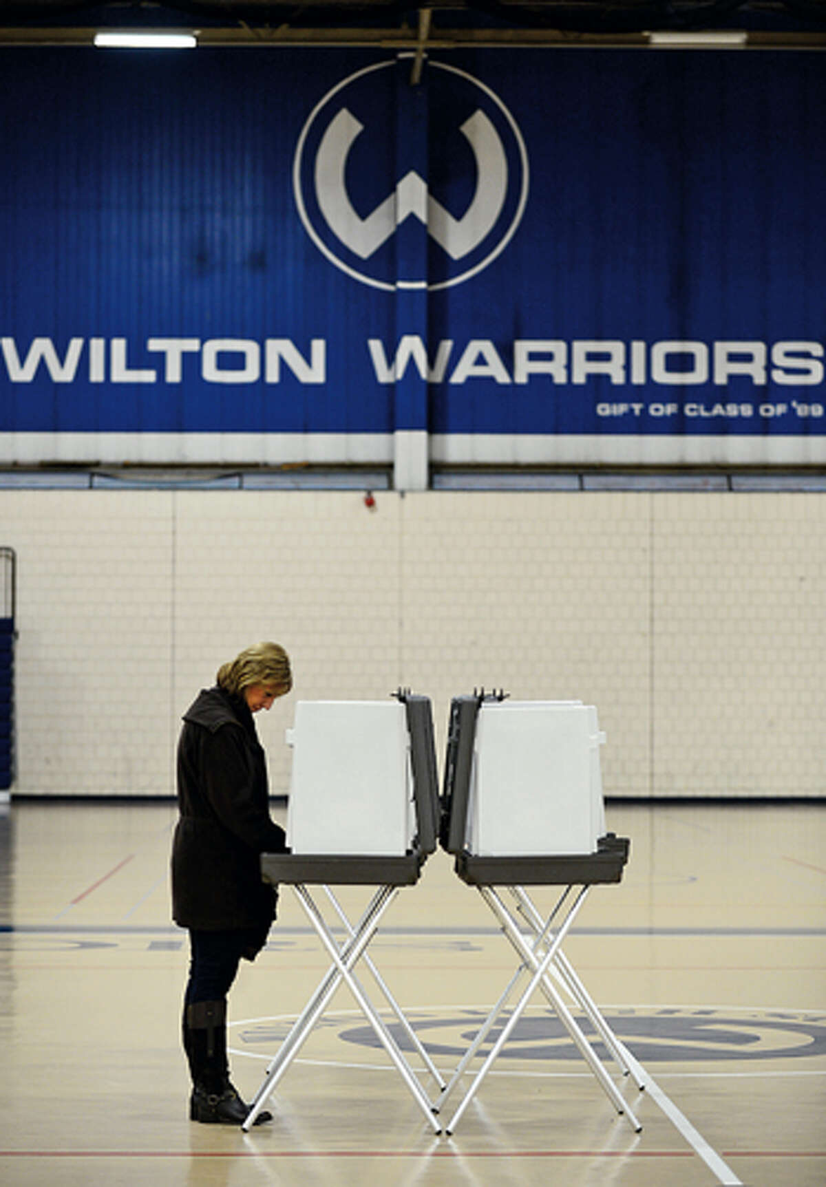 Wilton resident Debbie Ehrentreau cast her ballot at Wilton High School Tuesday. Hour photo / Erik Trautmann