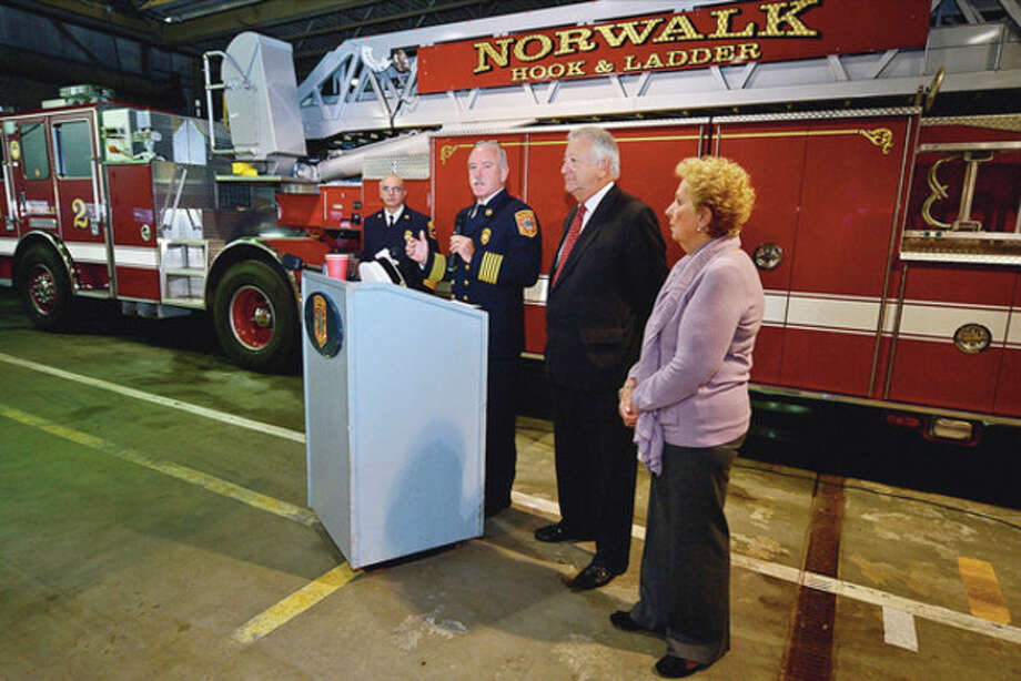 Norwalk FIre Chief Denis McCarthy speaks to 22 Norwalk firefighters along with an off duty Stamford Firefighter who were awarded with a special commendation Wednesday for their bravery in the rescue of two passengers from a sumerged vehicle at Veterean's Park on October 28th.Hour photo / Erik Trautmann / (C)2012, The Hour Newspapers, all rights reserved