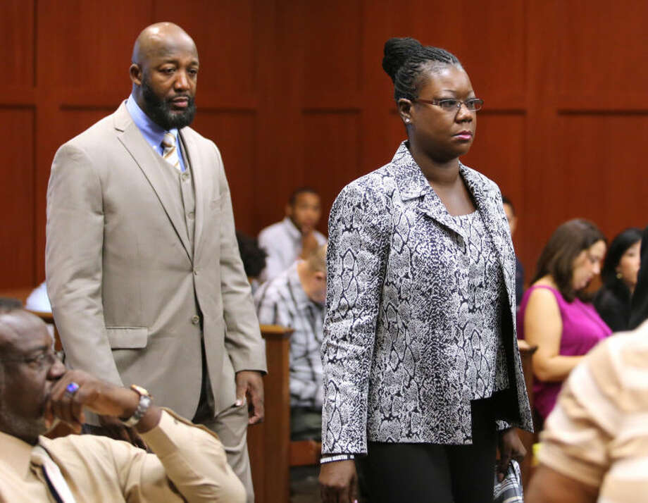 FILE - In this Tuesday, July 9, 2013 file photo, Tracy Martin and Sybrina Fulton, the parents of Trayvon Martin, arrive at the trial for George Zimmerman in Seminole Circuit Court, in Sanford, Fla. Martin and Fulton made appearances on network morning shows Thursday, July 18, 2013, saying they are still shocked that jurors acquitted George Zimmerman in the 2012 shooting death of their 17-year-old son. (AP Photo/Orlando Sentinel, Joe Burbank, Pool, File)