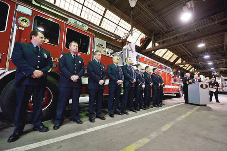 Hour photos / Erik TrautmannAbove, 22 Norwalk firefighters along with an off-duty Stamford firefighter are awarded a special commendation Wednesday for their bravery in the rescue of two passengers of a submerged vehicle at Veterans Memorial Park on Oct. 28. Below, Assistant Chief Gino Gatto speaks on the actions of the 22 Norwalk firefighters. / (C)2012, The Hour Newspapers, all rights reserved