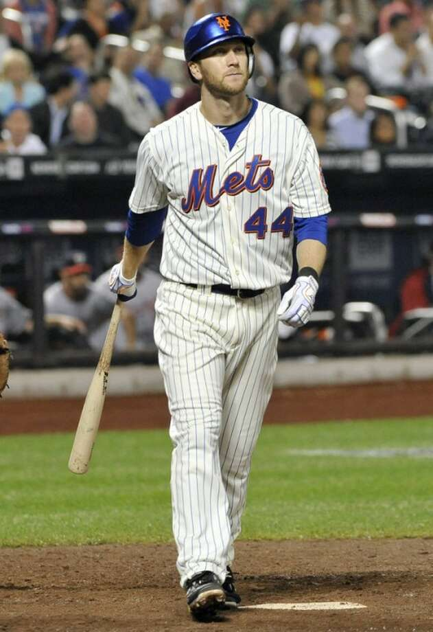 FILE - In this Sept. 19, 2011, file photo, New York Mets' Jason Bay (44) heads to the dugout after striking out in the ninth inning of a baseball game against the Washington Nationals in New York. The Mets and Bay have agreed to terminate their contract a year early and make the outfielder a free agent, the team announced on Wednesday, Nov. 7, 2012. The 34-year-old Bay was a major disappointment in New York after signing a $65 million, four-year deal. (AP Photo/Kathy Kmonicek, File)