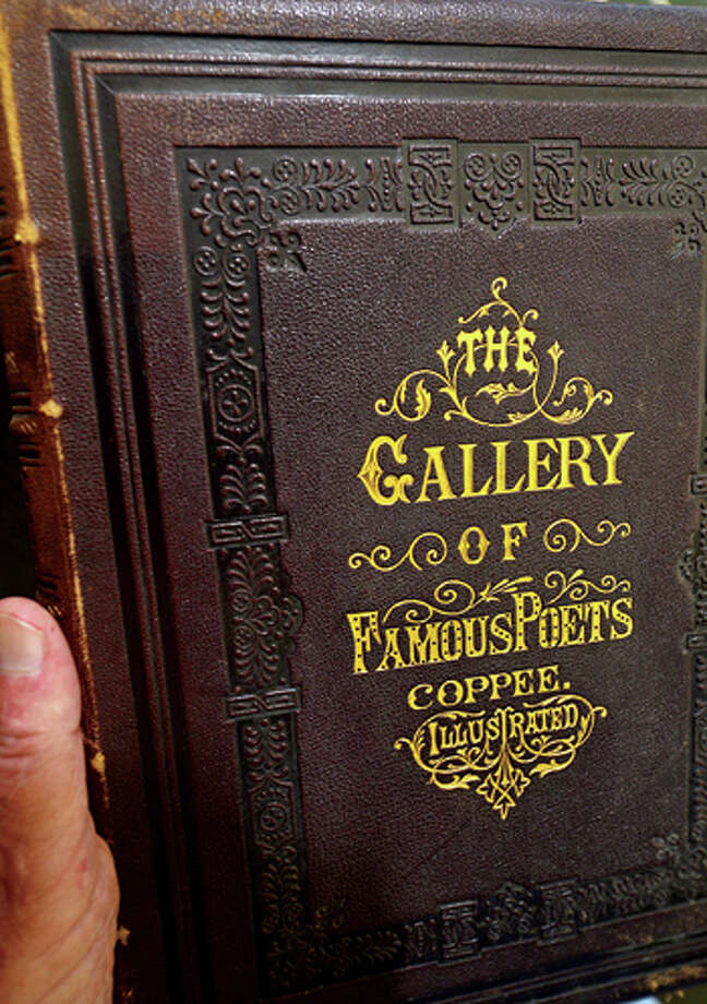 A copy of The Gallery of Famous Poets with a essay by Henry Coppe from 1873 will be for sale at the Westport Public Library's 21st annual Summer Book Sale July 20-23. Hour photo / Erik Trautmann / (C)2013, The Hour Newspapers, all rights reserved