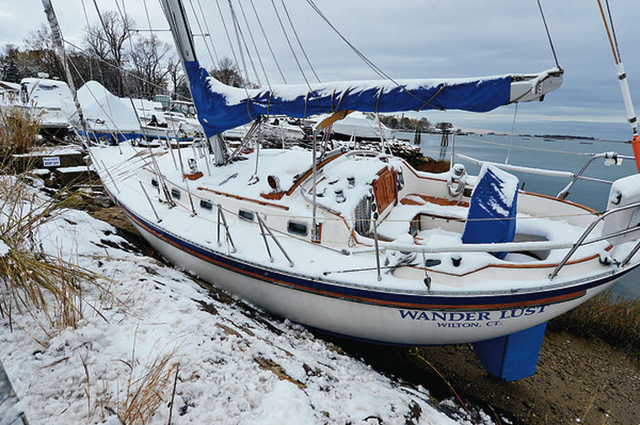 The Wander Lust sits a ground in Bell Island a week after a devastating hurricane and a Nor' Easter left several inches of snow on the ground Thursday. Hour photo / Erik Trautmann / (C)2012, The Hour Newspapers, all rights reserved