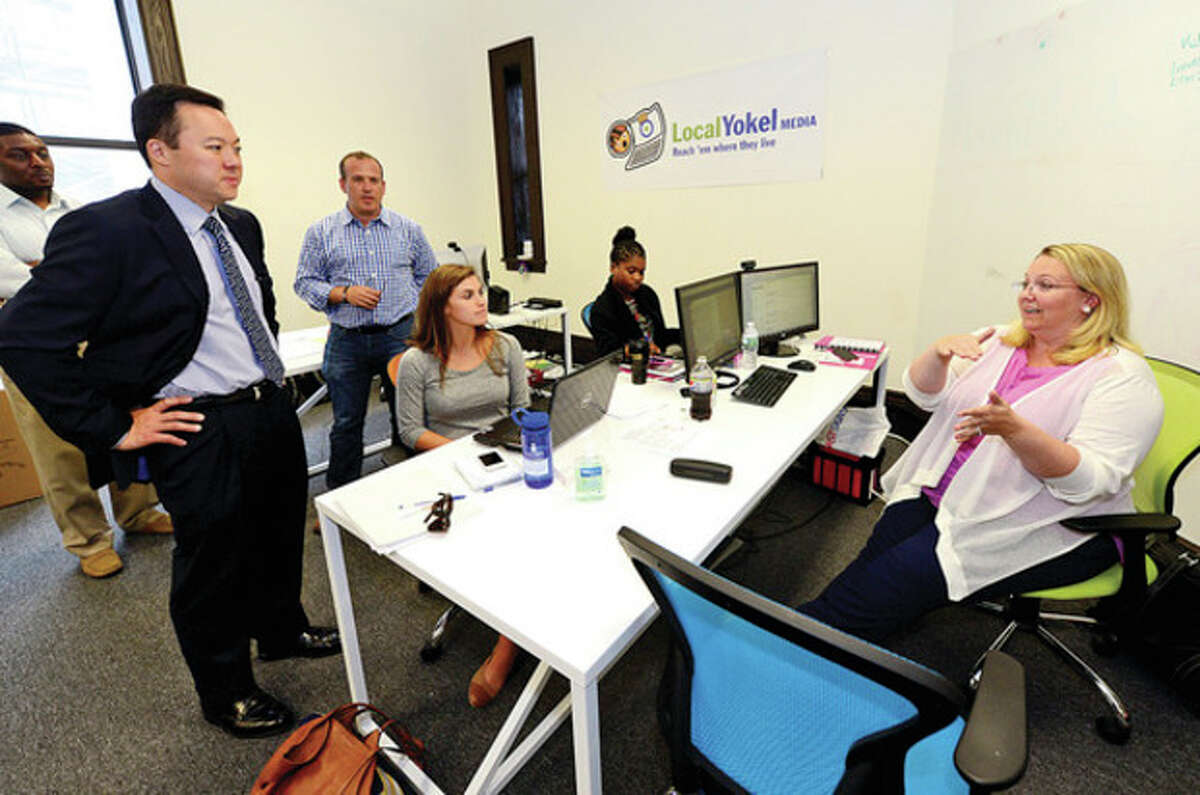 State representative William Tong, democratic candidate for mayor of Stamford, is given a tour of the Stamford Innovation Center by VP of Marketing for the Center, Peter Propp, where he meets Reilly O'Connor, Keisha Eddie and Nicole Lyons of LocalYokel.com Thursday. Hour photo / Erik Trautmann