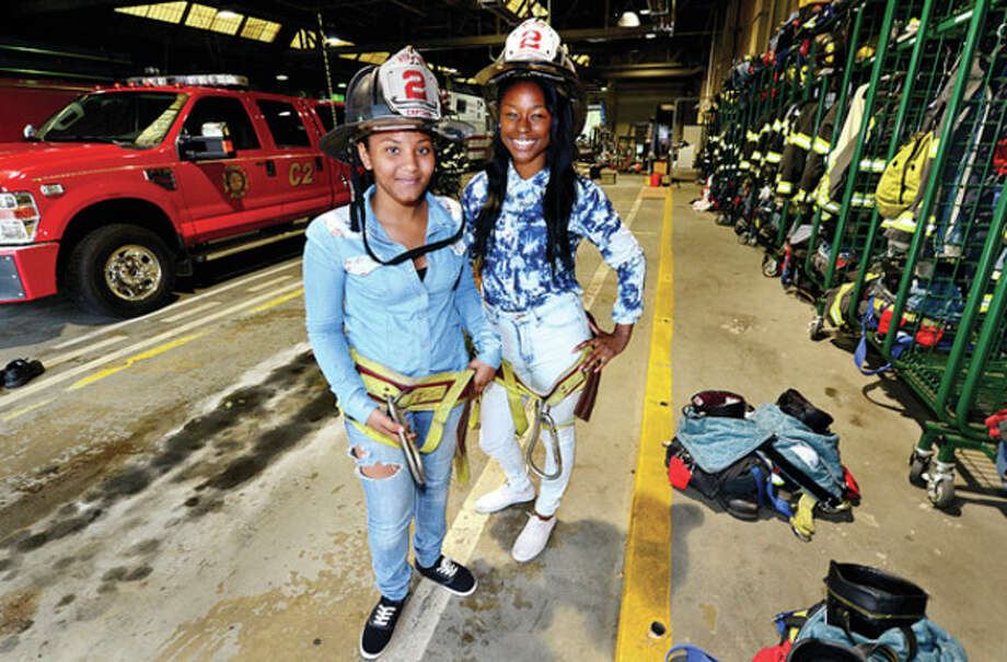 Norwalk Fire Department interns, Alexus Phillips and Aquario Strachan, are part of 2013 Mayor's Summer Youth Jobs program. Although they have been doing primarily office work, they also have been shown other functions of the Norwalk Fire Department.Hour photo / Erik Trautmann / (C)2013, The Hour Newspapers, all rights reserved