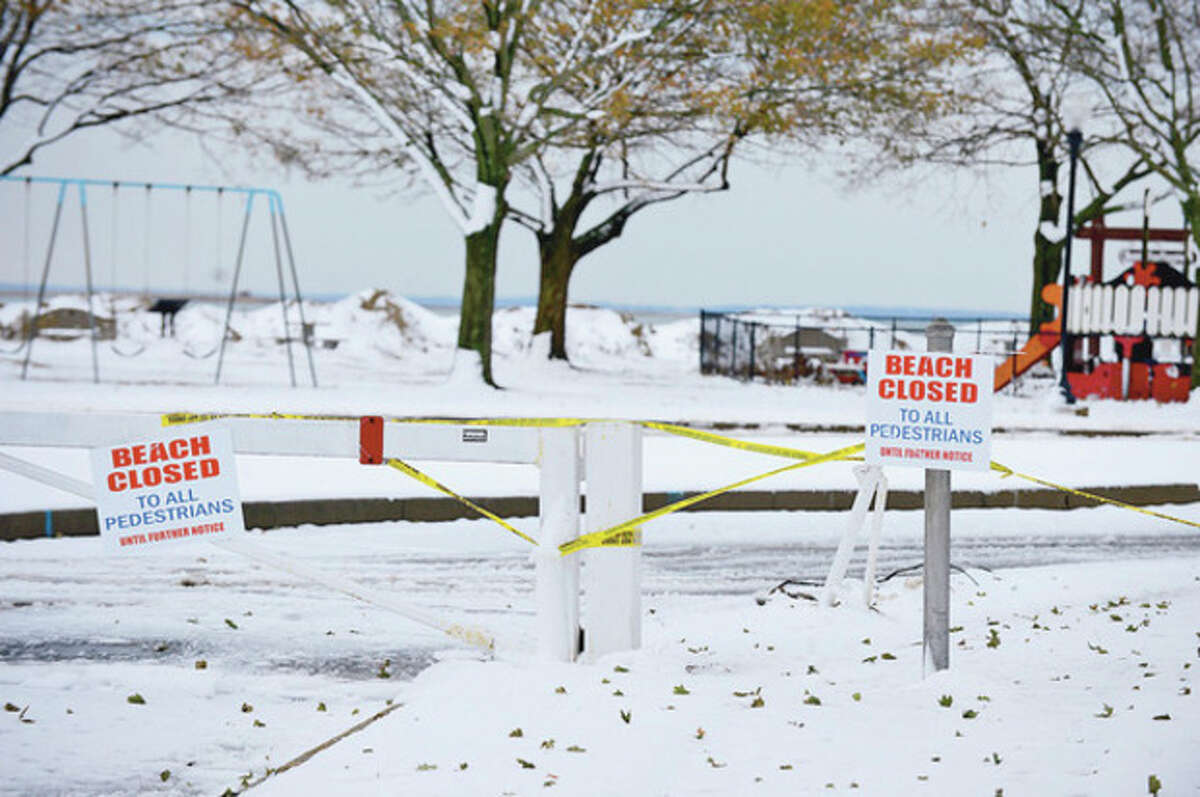 A week after a devastating hurricane Norwalk and after a Nor' Easter left several inches of snow on the ground Thursday Calf Pasture Beach remains closed. Hour photo / Erik Trautmann