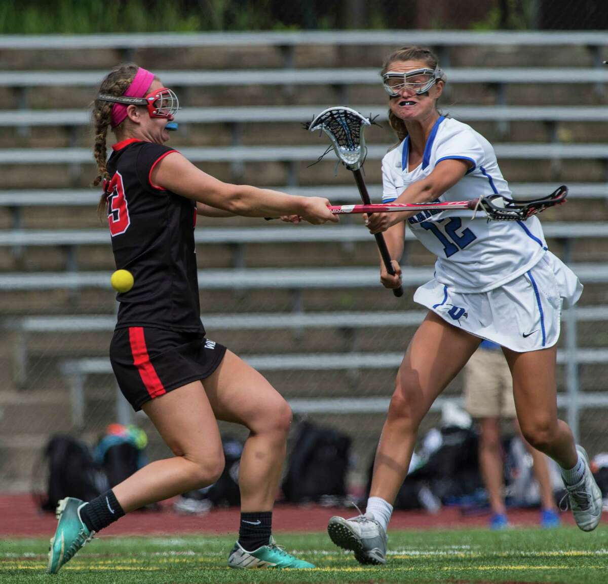 Darien High School's Susannah Ropp shoots and scores during the CIAC class L championship game against Fairfield Warde High School played at Jonathan Law High School, Milford, Conn. Saturday, June 11, 2016.