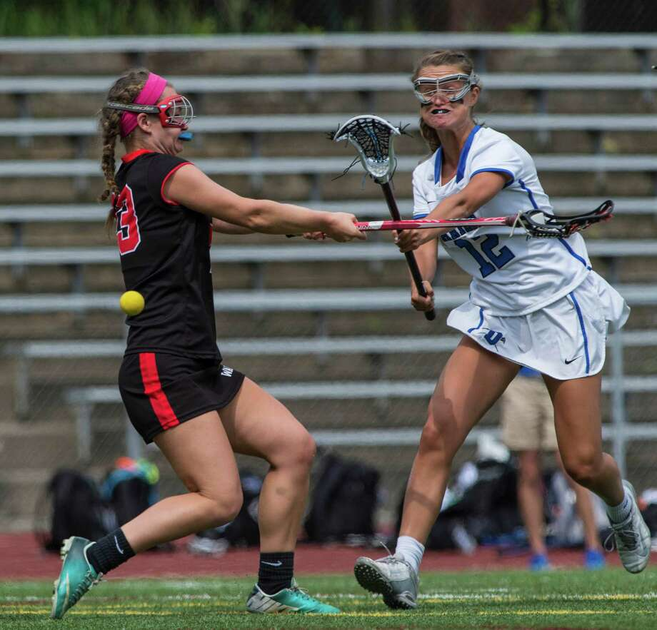 Darien High School's Susannah Ropp shoots and scores during the CIAC class L championship game against Fairfield Warde High School played at Jonathan Law High School, Milford, Conn. Saturday, June 11, 2016. Photo: Mark Conrad / For Hearst Connecticut Media / Connecticut Post Freelance