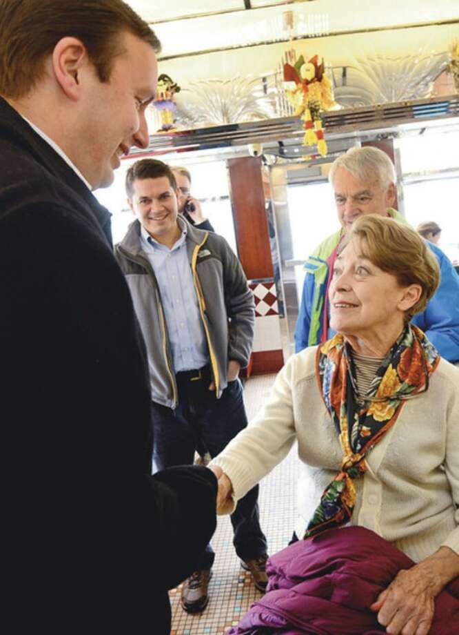 Democratic candidate for State Representative 142nd seat, Kate Tepper, greets newly elected US Senator Chris Murphy at The Post Rd Diner Thursday.Hour photo / Erik Trautmann