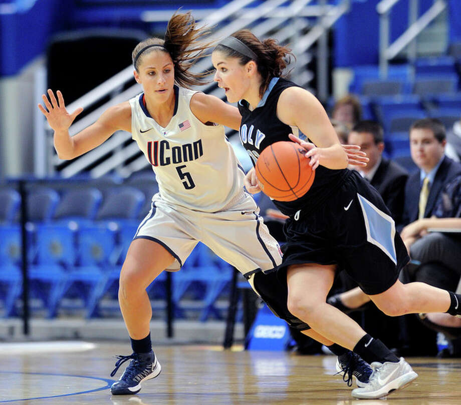 Connecticut's Caroline Doty, left, guards Holy Family's Molly Hanlon during the first half of an exhibition NCAA college basketball game in Hartford, Conn., on Wednesday, Nov. 7, 2012. (AP Photo/Fred Beckham) / FR153656 AP