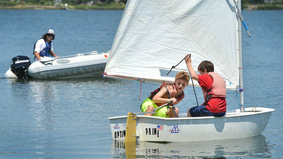 Evan Goldbaum and Tristan Barry set sail during SoundWaters summer camp Opti program sailing school.