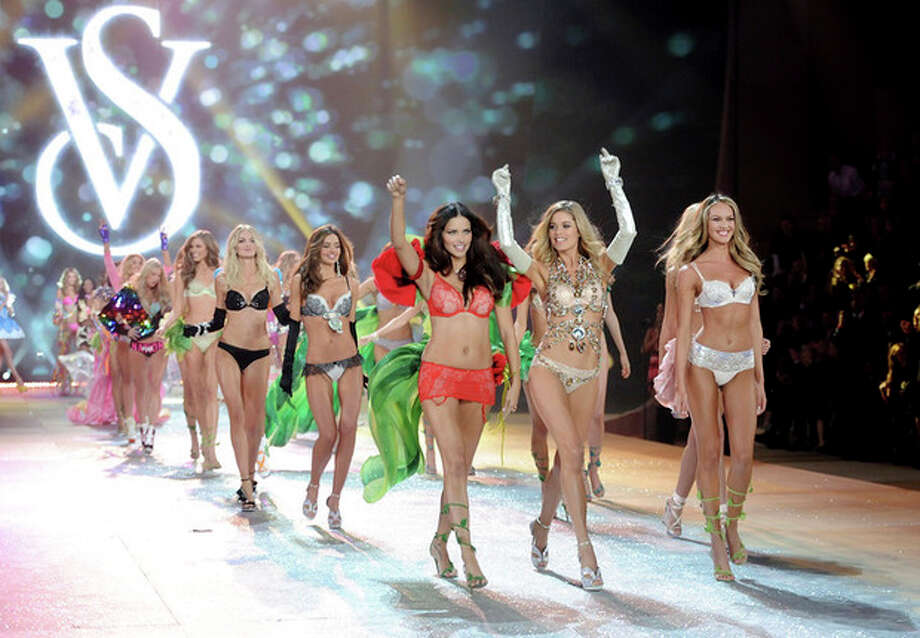 Models Adriana Lima, left, Doutzen Kroes and Candice Swanepoel, right, lead the final runway walk during the 2012 Victoria's Secret Fashion Show on Wednesday Nov. 7, 2012 in New York. The show will be broadcast on Tuesday, Dec. 4 (10:00 PM, ET/PT) on CBS. (Photo by Evan Agostini/Invision/AP) / Invision