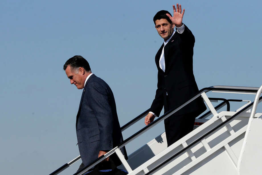 Republican presidential candidate, former Massachusetts Gov. Mitt Romney, followed by his vice presidential running mate, Rep. Paul Ryan, R-Wis., walk off Romney's plane in Cleveland, Ohio, Tuesday, Nov. 6, 2012. Ryan arrived moments earlier on his own plane and met Romney on board. (AP Photo/Charles Dharapak) / AP