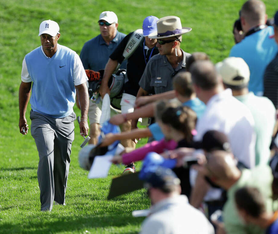 Tiger Woods walks to the 16th tee during a practice round for the PGA Championship golf tournament at Oak Hill Country Club, Tuesday, Aug. 6, 2013, in Pittsford, N.Y. (AP Photo/Charlie Neibergall) / AP