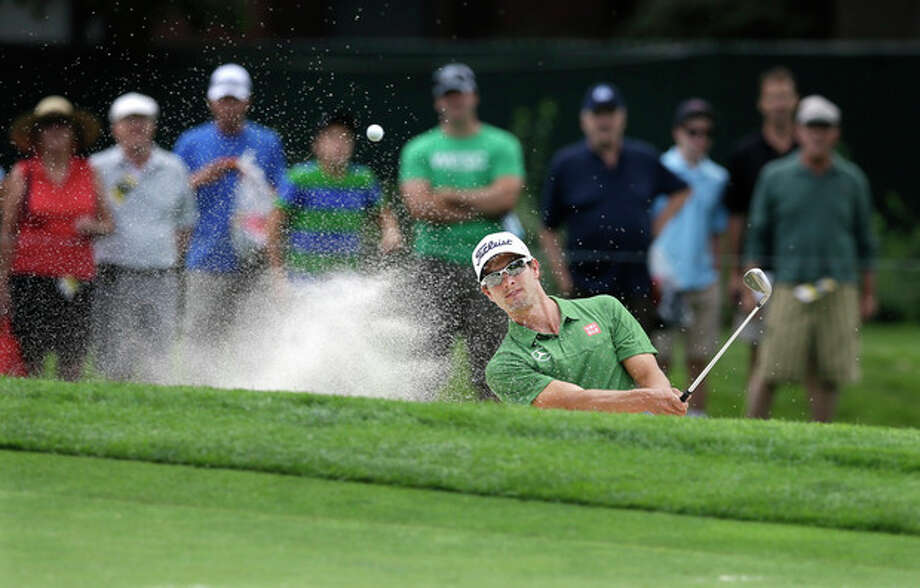 Adam Scott, of Australia, hits from a bunker on the fourth hole during a practice round for the PGA Championship golf tournament at Oak Hill Country Club, Tuesday, Aug. 6, 2013, in Pittsford, N.Y. (AP Photo/Patrick Semansky) / AP