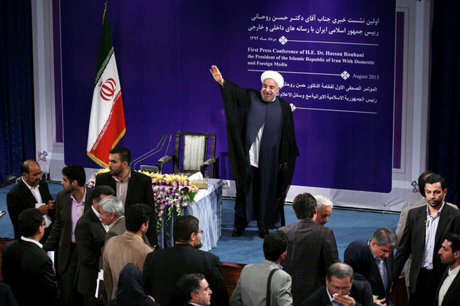 """Iranian President Hasan Rouhani speaks at his first press conference since taking office at the presidency compound in Tehran, Iran, Tuesday, Aug. 6, 2013. Rouhani says his country is ready for """"serious"""" and swift talks with world powers over the nation's controversial nuclear program. (AP Photo/Ebrahim Noroozi) / AP"""