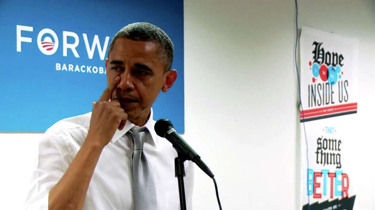 """In this still image from a BarackObama.com campaign video, President Barack Obama wipes away tears as he thanks members of his campaign staff and volunteers in Chicago, Wednesday, Nov. 7, 2012. The short speech came a day after he won re-election. The president talks about his work as a community organizer in Chicago and tells staffers and volunteers that they will do """"amazing things"""" in their lives. Obama becomes emotional when he says that even before the election results, he felt the work he had done """"had come full circle."""" He tells staff members that he is proud of the work they did, then pauses to wipe away tears. (AP PhotoBarackObama.com)"""
