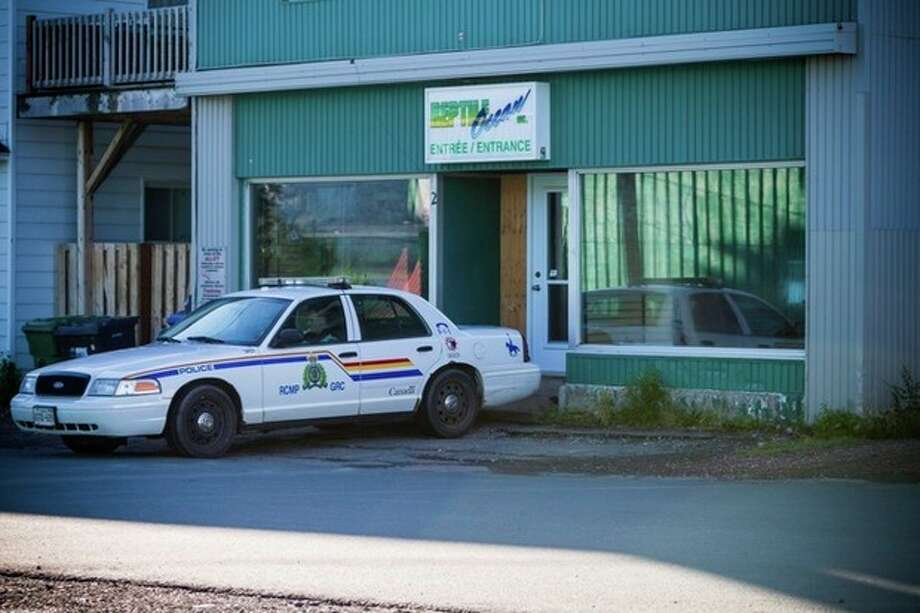 "A Royal Canadian Mounted Police cruiser sits outside the Reptile Ocean exotic pet store in Campbellton, New Brunswick, Canada, on Tuesday, Aug. 6, 2013. Autopsies will be performed Tuesday on two young boys who were strangled in their sleep by a large 4.3 meter African rock python that escaped from the pet store and slithered through a ventilation system and crashed down from the ceiling into the living room of an apartment upstairs from the pet store. The brothers, ages 5 and 7, were visiting the apartment of a friend above Reptile Ocean Inc. said Royal Canadian Mounted Police Const. Julie Rogers-Marsh. The store owner, Jean-Claude Savoie, said he didn't hear a sound during the incident and discovered the ""horrific scene"" when he went into his living room, where the two boys had been sleeping, on Monday morning. Savoie said the snake fell through the living room from the ceiling. (AP Photo/The Canadian Press, John LeBlanc) / The Canadian Press"