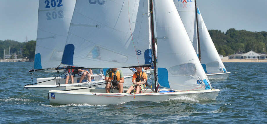 Hour Photo/Alex von Kleydorff. Cedar Point Yacht Club's entry skipperd by Ethan Steur and crewed by Coyey Hausman look for clean air during the Pixels Championship at Norwalk Yacht Club