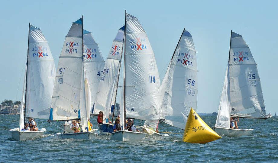 Hour Photo/Alex von Kleydorff. Pixel sailboats round the marker during the Junior Sailing Association's Pixel Championships at Norwalk Yacht Club