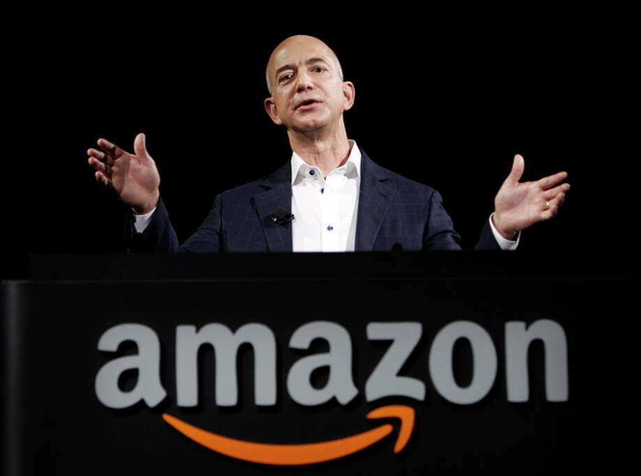 FILE - In this Sept. 6, 2012 file photo, Amazon founder and CEO Jeff Bezos speaks in Santa Monica, Calif. Bezos plans to buy The Washington Post for $250 million. (AP Photo/Reed Saxon, File) / AP