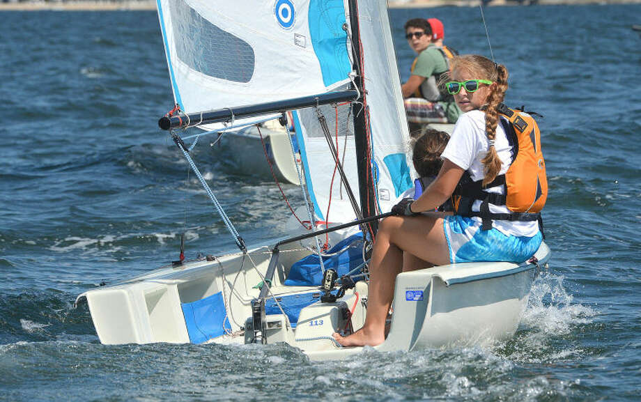 Hour Photo/Alex von Kleydorff. Skipper Claire Wagner takes al look aft to make sure she has a good position for the start of race 1 of the Pixel Championship at Norwalk Yacht Club on Tuesday