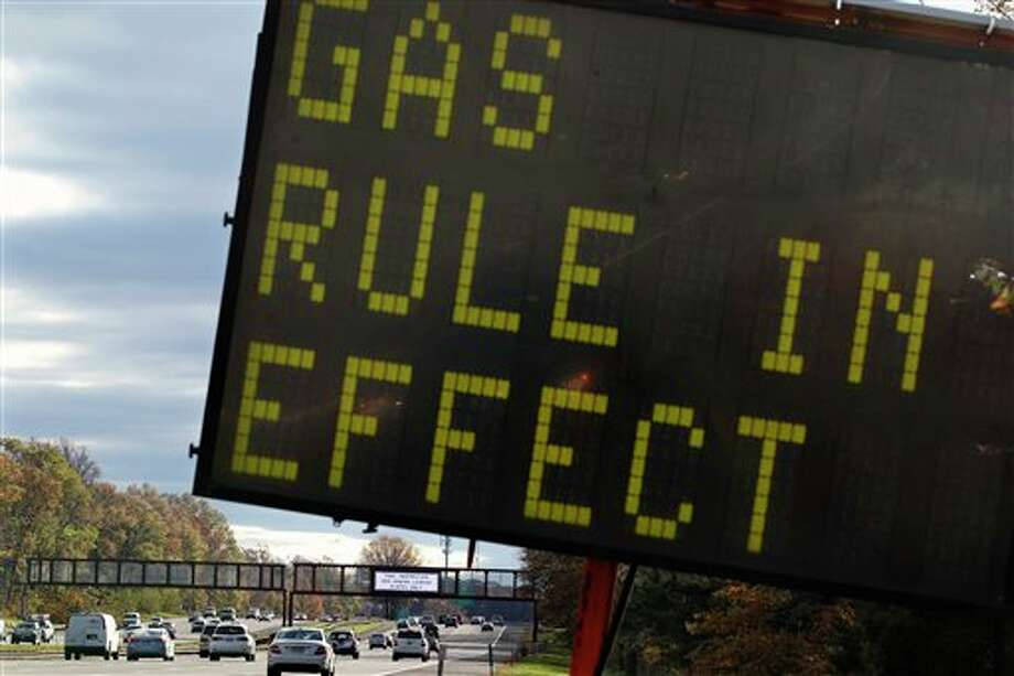 A sign is seen on the Garden State Parkway near Woodbridge, N.J., after a gas rationing system ordered by Gov. Chris Christie went into effect at noon Saturday, Nov. 3, 2012. Drivers with license plates ending in an even number will be allowed to buy gas on even-numbered days, and those with plates ending in an odd number can make gas purchases on odd-numbered days. Christie says it will help ease fuel shortages and extended lines for gasoline that have occurred since superstorm Sandy decimated the coast. The order affects Bergen, Essex, Hudson, Hunterdon, Middlesex, Morris, Monmouth, Passaic, Somerset, Sussex, Union and Warren counties. (AP Photo/Mel Evans) / AP